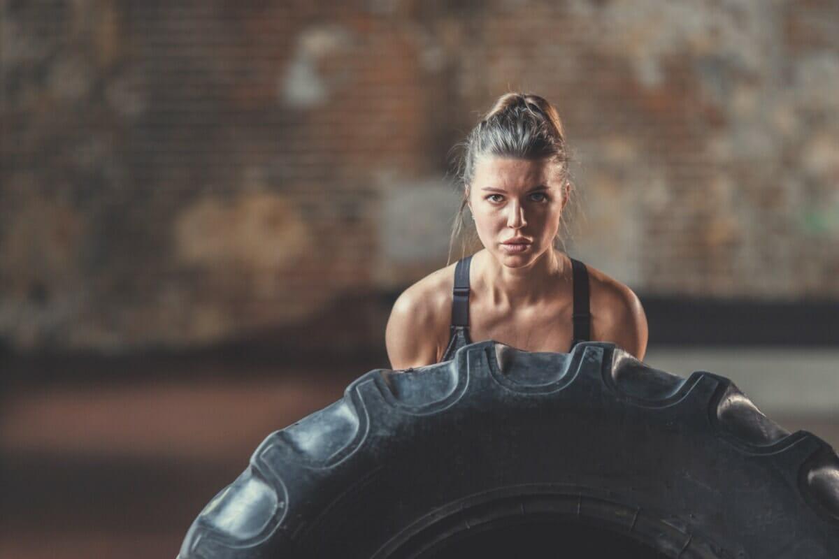 CrossFit Woman pushing tire