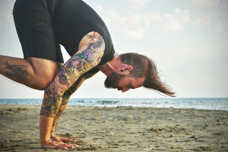 practicing inverted handstand poses and asanas