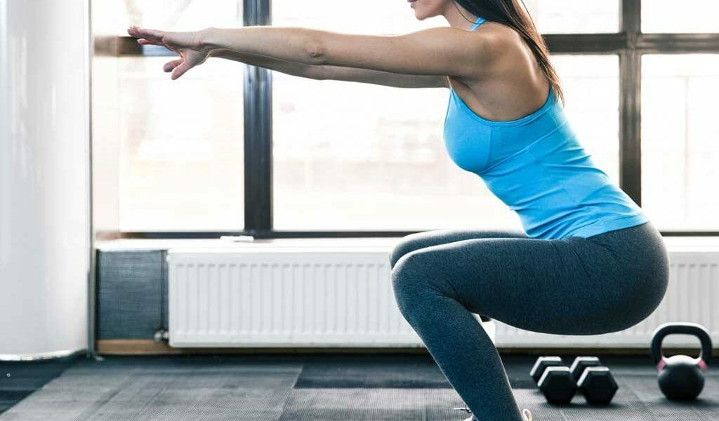 woman squatting correctly