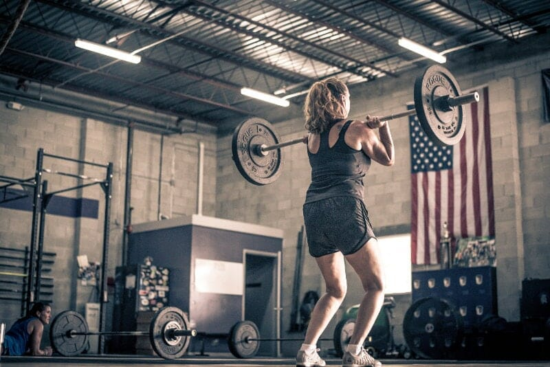 woman performing power clean