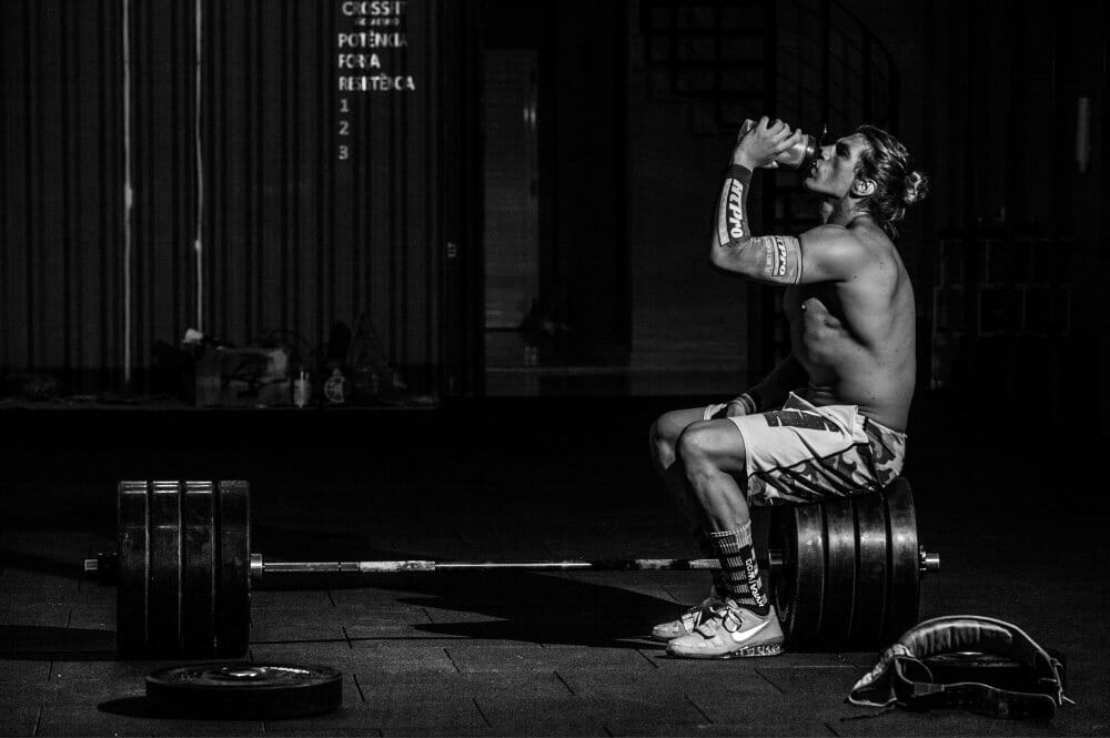 CrossFit athlete consuming supplements post workout