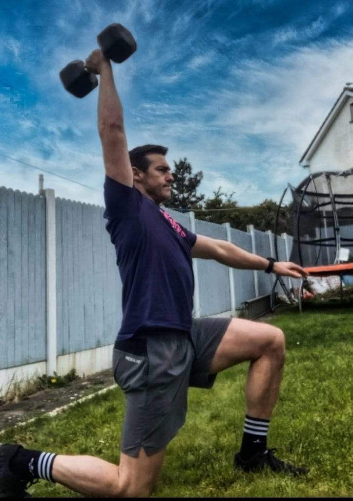 Lunge Position Of Overhead Dumbbell Walk