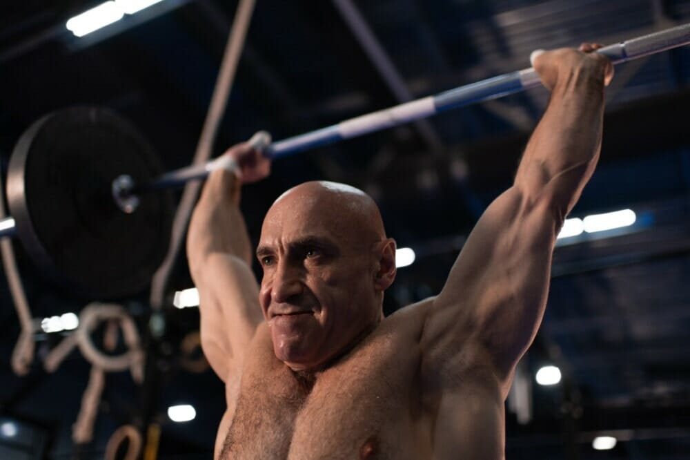 Sweaty Elderly Sportsman Lifting Barbell