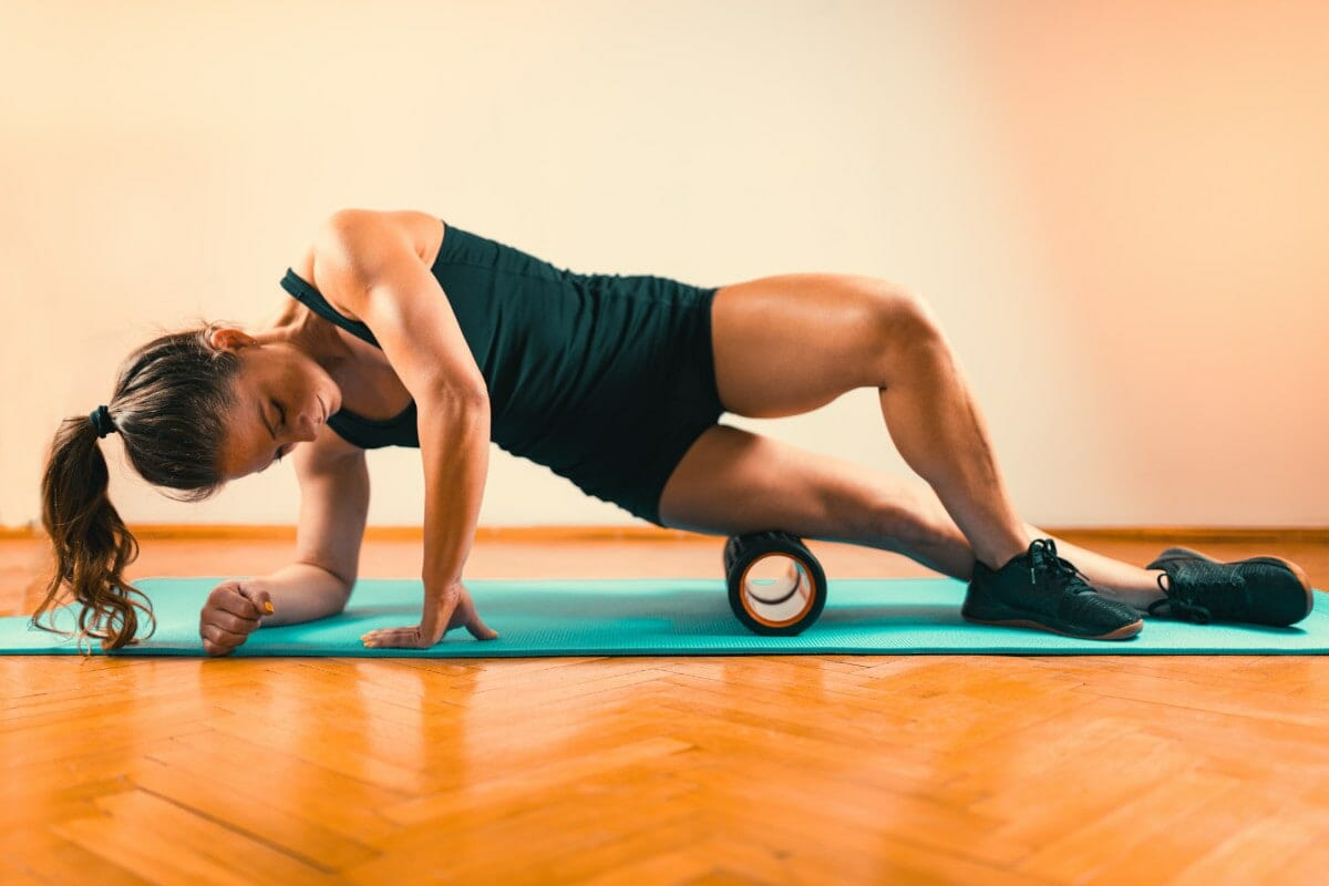 side of quadriceps mobility exercise with roller