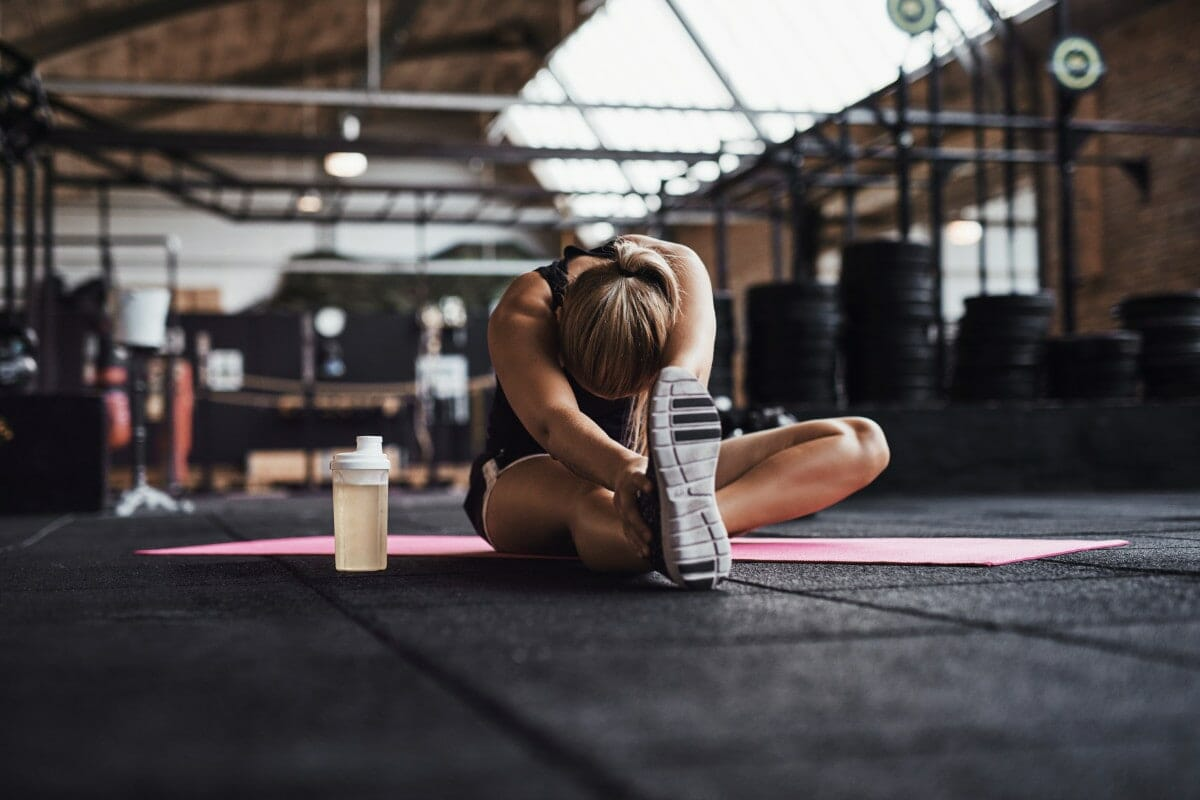 woman stretching in crossfit box
